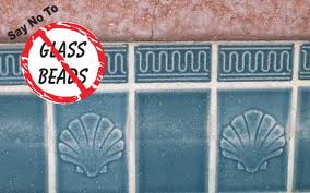 Glass Beads can pit and damage tile.